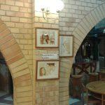 Kávéfestmények a boltívnél